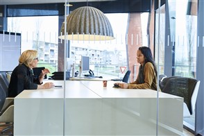 Statistics Netherlands employees sitting at a conference table
