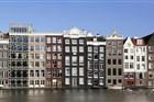 Huizen aan de overkant van het Damrak, Amsterdam