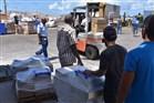 Men loading and unloading goods