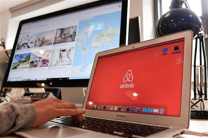 Person behind computer wants to book a digital service on Airbnb