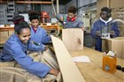 4 eritreese vluchtelingen op de leerwerkplaats van de Praktijkschool Breda