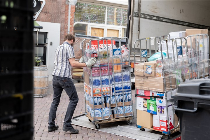 A man unloads food from a lorry