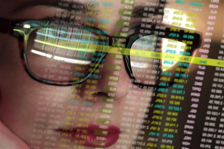 Woman behind computer