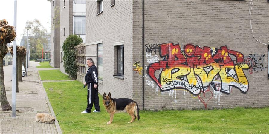 Graffiti op muur woonhuis